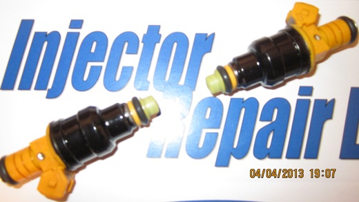 Refurbished fuel injectors after cleaning and flow testing with all new parts.